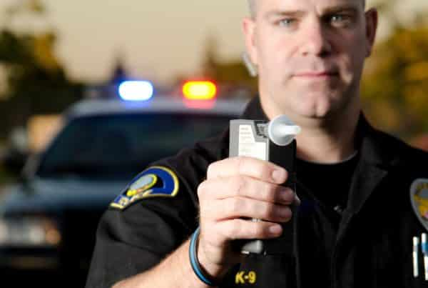 Drunk driving picture of police presenting breathalyzer