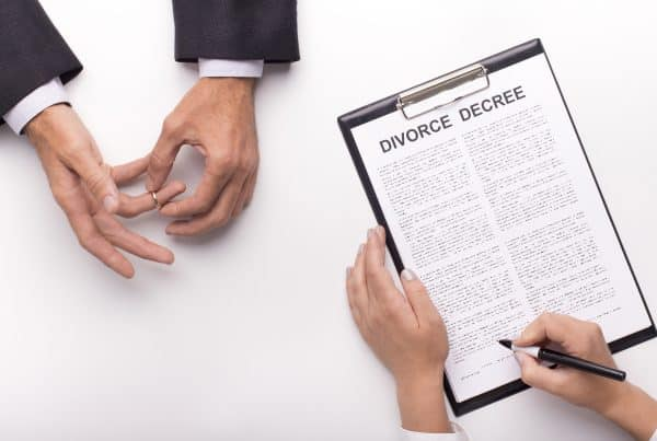 Lawyer draw up divorce decree on planner
