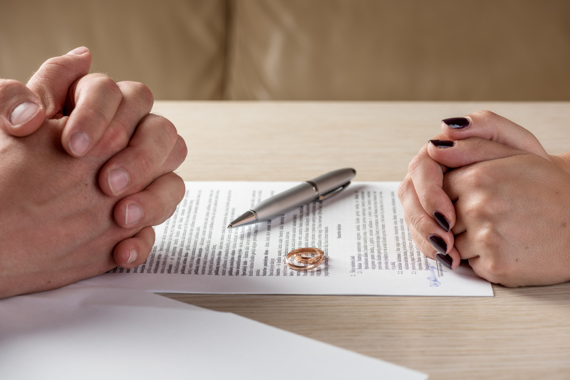 Wife and husband signing divorce documents child support agreement